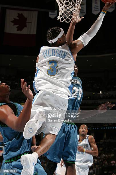 Allen Iverson of the Denver Nuggets goes to the basket against the Minnesota Timberwolves on November 23 2007 at the Pepsi Center in Denver Colorado...