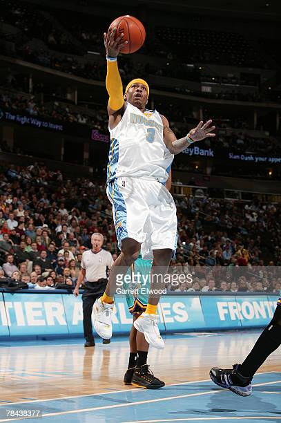 Allen Iverson of the Denver Nuggets goes to the basket against the New Orleans Hornets on December 12 2007 at the Pepsi Center in Denver Colorado...