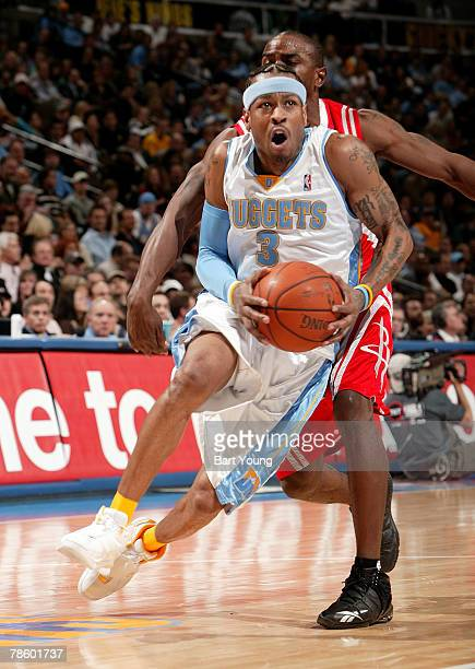 Allen Iverson of the Denver Nuggets goes to the basket against the Houston Rockets at the Pepsi Center December 20 2007 in Denver Colorado NOTE TO...