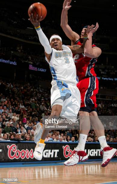 Allen Iverson of the Denver Nuggets goes to the basket against the New Jersey Nets on January 25 2008 at the Pepsi Center in Denver Colorado NOTE TO...