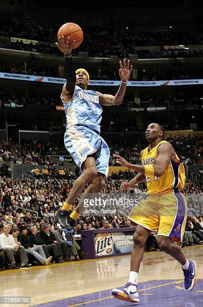 Allen Iverson of the Denver Nuggets goes to the hoop against Kobe Bryant of the Los Angeles Lakers on January 5 2007 at Staples Center in Los Angeles...
