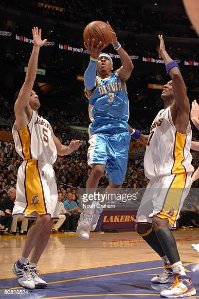Allen Iverson of the Denver Nuggets goes up for a shot against Jordan Farmar and Lamar Odom of the Los Angeles Lakers in Game One of the Western...