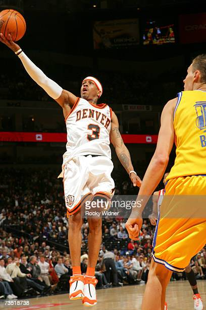 Allen Iverson of the Denver Nuggets goes up for the layup against the Golden State Warriors at Oracle Arena March 7 2007 in Oakland California NOTE...