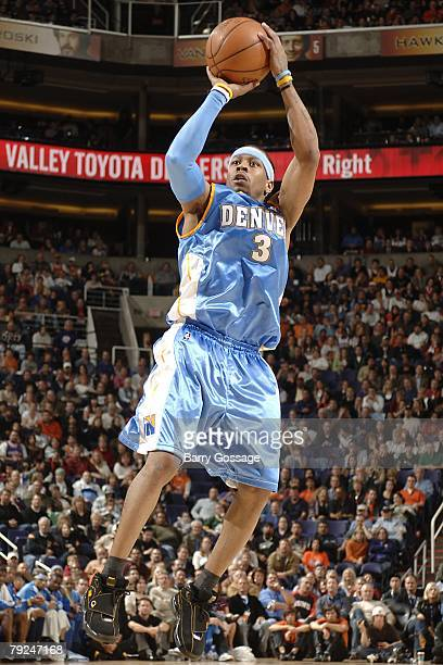 Allen Iverson of the Denver Nuggets goes up for the shot during the NBA game against the Phoenix Suns on January 7 2008 at US Airways Center in...