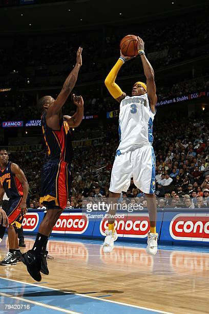 Allen Iverson of the Denver Nuggets goes up for the shot during the NBA game against the Golden State Warriors on December 30 2007 at the Pepsi...