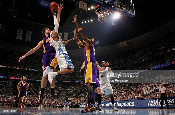 Allen Iverson of the Denver Nuggets has a shot blocked by Pau Gasol of the Los Angeles Lakers in Game Four of the Western Conference Quarterfinals...