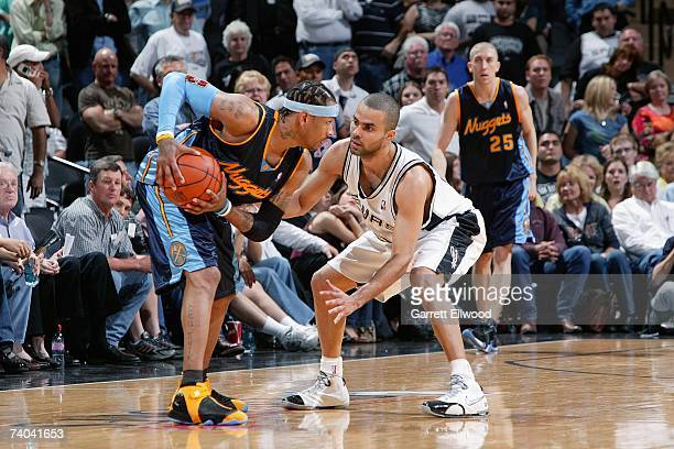 Allen Iverson of the Denver Nuggets holds the ball against Tony Parker of the San Antonio Spurs in Game One of the Western Conference Quarterfinals...