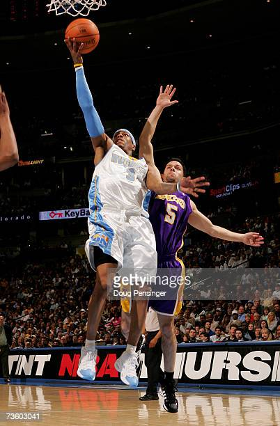Allen Iverson of the Denver Nuggets lays up a shot in front of Jordan Farmar of the Los Angeles Lakers as the Nuggets defeated the Lakers during NBA...