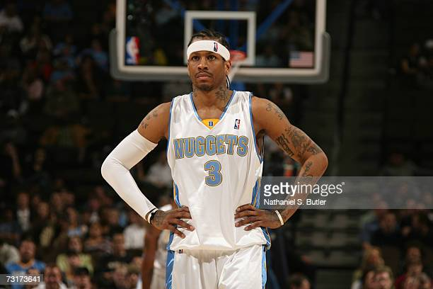 Allen Iverson of the Denver Nuggets looks on during a game against the Milwaukee Bucks at the Pepsi Center on January 8 2006 in Denver Colorado The...