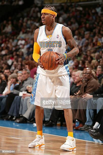 Allen Iverson of the Denver Nuggets looks to move the ball during the NBA game against the Toronto Raptors on March 14 2008 at the Pepsi Center in...