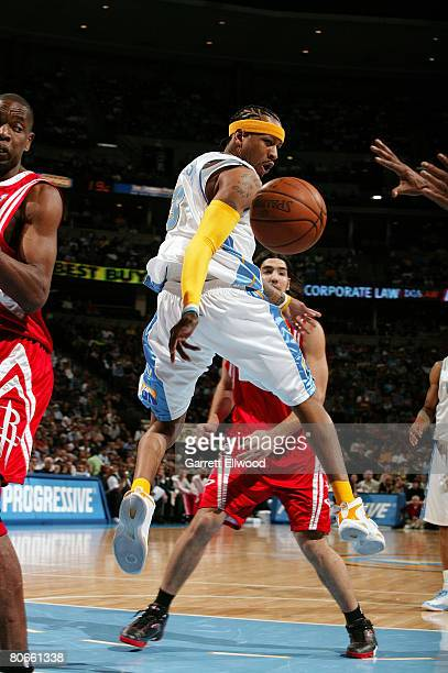 Allen Iverson of the Denver Nuggets looks to pass against the Houston Rockets at the Pepsi Center April 13 2008 in Denver Colorado NOTE TO USER User...