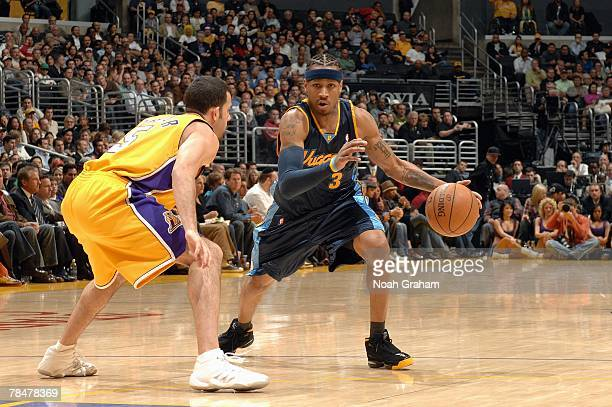 Allen Iverson of the Denver Nuggets makes a move against Jordan Farmar of the Los Angeles Lakers during the game at Staples Center on November 29...