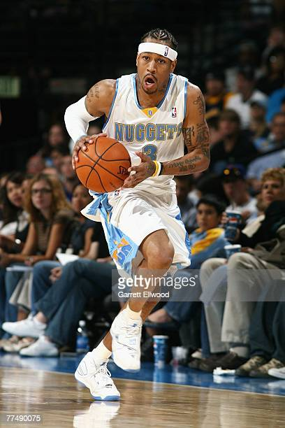 Allen Iverson of the Denver Nuggets moves the ball up court during a preseason game against the Los Angeles Clippers at the Pepsi Center on October 9...