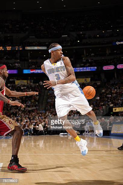 Allen Iverson of the Denver Nuggets passes the ball against the Cleveland Cavaliers on January 19 2006 at the Pepsi Center in Denver Colorado NOTE TO...