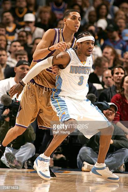 Allen Iverson of the Denver Nuggets plays defense against Kevin Martin of the Sacramento Kings at the Pepsi Center on December 22 2006 in Denver...