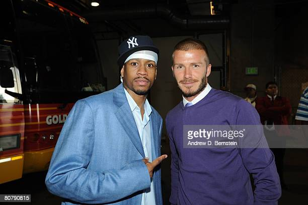 Allen Iverson of the Denver Nuggets poses with MLS player David Beckham of the Los Angeles Galaxy after Game One of the Western Conference...