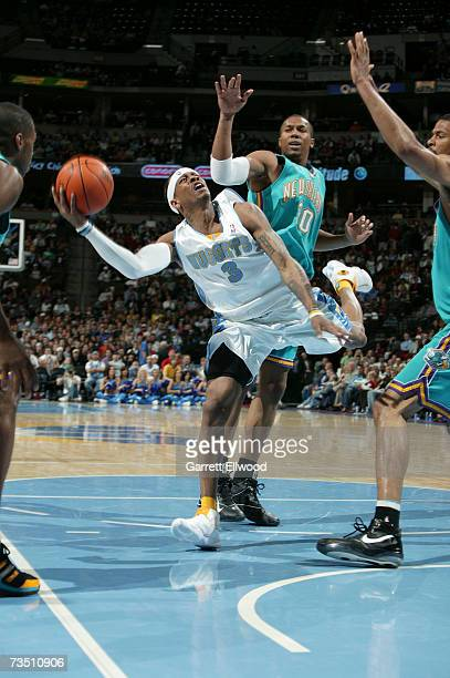 Allen Iverson of the Denver Nuggets put up a shot against David West of the New Orleans/Oklahoma City Hornets at the Pepsi Center March 6 2007 in...