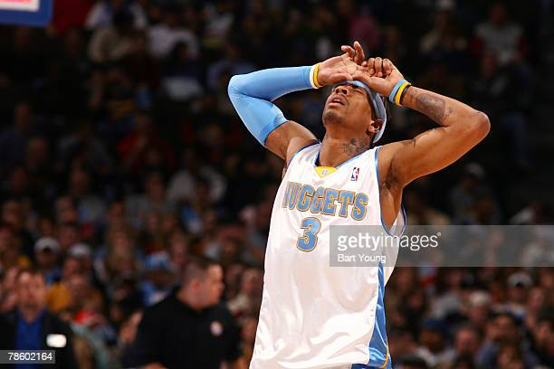 Allen Iverson of the Denver Nuggets reacts to a play against the Houston Rockets on December 20 2007 at the Pepsi Center in Denver Colorado NOTE TO...