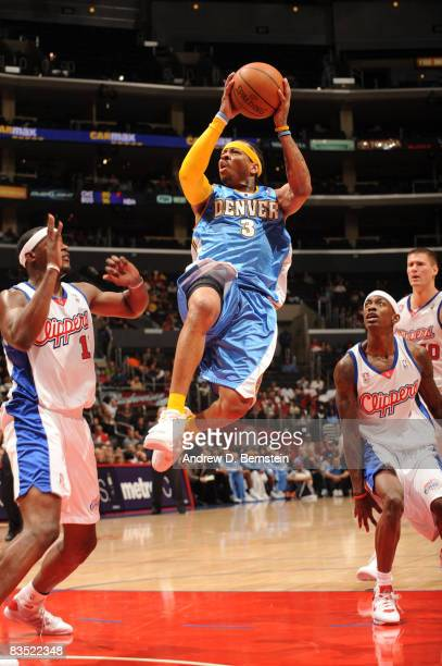 Allen Iverson of the Denver Nuggets rises for a shot against the Los Angeles Clippers at Staples Center on October 31 2008 in Los Angeles California...