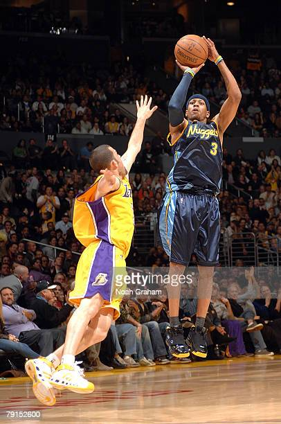 Allen Iverson of the Denver Nuggets shoots a jumper against Jordan Farmar of the Los Angeles Lakers at Staples Center January 21 2008 in Los Angeles...