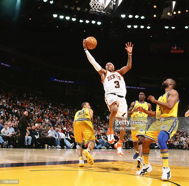 Allen Iverson of the Denver Nuggets shoots a layup against Baron Davis of the Golden State Warriors during a game at Oracle Arena on March 7 2007 in...