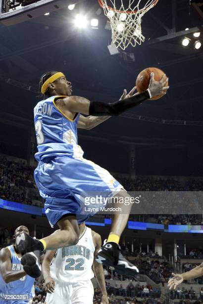 Allen Iverson of the Denver Nuggets shoots a reverse layup against the New Orleans/Oklahoma City Hornets during an NBA game at the Ford Center...