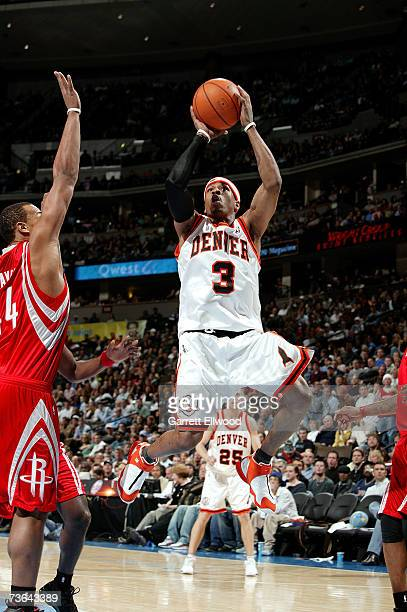 Allen Iverson of the Denver Nuggets shoots against Chuck Hayes of the Houston Rockets at Pepsi Center on March 2 2007 in Denver Colorado The Rockets...