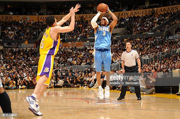 Allen Iverson of the Denver Nuggets shoots against Jordan Farmar of the Los Angeles Lakers in Game Two of the Western Conference Quarterfinals during...