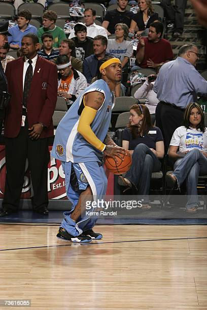 Allen Iverson of the Denver Nuggets shoots during warm ups before the NBA game against the Dallas Mavericks on February 24 2007 at American Airlines...