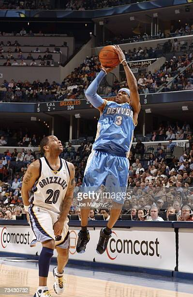 Allen Iverson of the Denver Nuggets shoots over Damon Stoudamire of the Memphis Grizzlies on February 26, 2007 at FedExForum in Memphis, Tennessee....