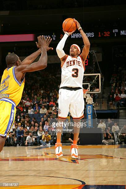 Allen Iverson of the Denver Nuggets shoots the jump shot against Jason Richardson of the Golden State Warriors at Oracle Arena March 7 2007 in...