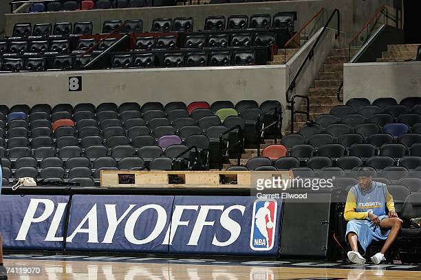 Allen Iverson of the Denver Nuggets sits on the sideline during practice for the Western Conference Quarterfinals against the San Antonio Spurs...