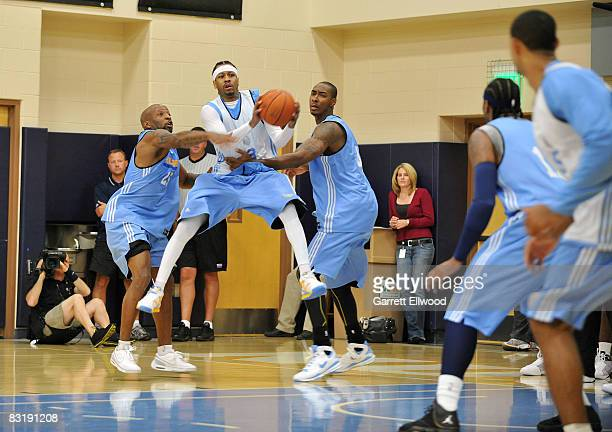 Allen Iverson of the Denver Nuggets splits defenders during practice on October 9 2008 at the Pepsi Center in Denver Colorado NOTE TO USER User...
