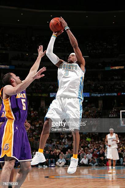 Allen Iverson of the Denver Nuggets takes a shot against Jordan Farmar of the Los Angeles Lakers on December 5 2007 at the Pepsi Center in Denver...