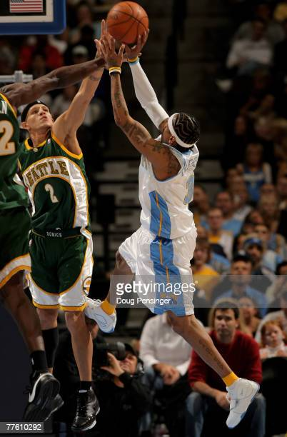 Allen Iverson of the Denver Nuggets tries to get off a shot over Delonte West of the Seattle SuperSonics at the Pepsi Center on October 31 2007 in...
