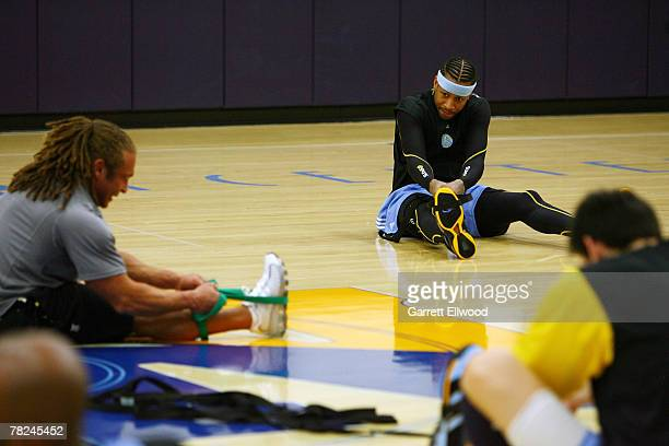 Allen Iverson of the Denver Nuggets watches strength and conditioning coach Steve Hess during practice on December 4 2007 at the Pepsi Center in...