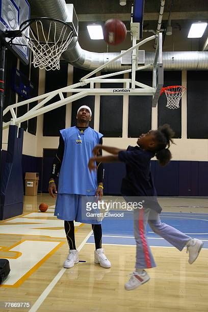 Allen Iverson of the Denver Nuggets works with kids from Warren Village during a basketball clinic on November 3 2007 at the Pepsi Center in Denver...