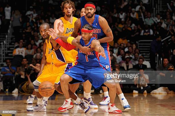 Allen Iverson of the Detroit Pistons and Kobe Bryant of the Los Angeles Lakers go after a loose ball during the game on November 14 2008 at Staples...