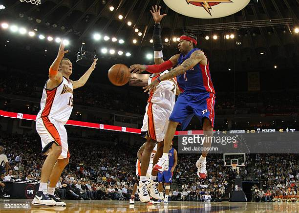 Allen Iverson of the Detroit Pistons drives against CJ Watson and Andris Biedrins of the Golden State Warriors during an NBA game on November 13 2008...