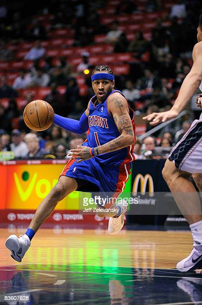 Allen Iverson of the Detroit Pistons drives past Brook Lopez of the New Jersey Nets during their game November 7 2008 at the Izod Arena in East...