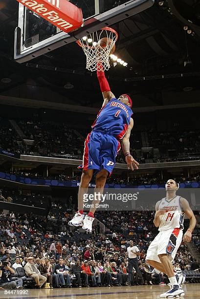 Allen Iverson of the Detroit Pistons dunks the ball past DJ Augustin of the Charlotte Bobcats during the game on December 13 2008 at Charlotte...