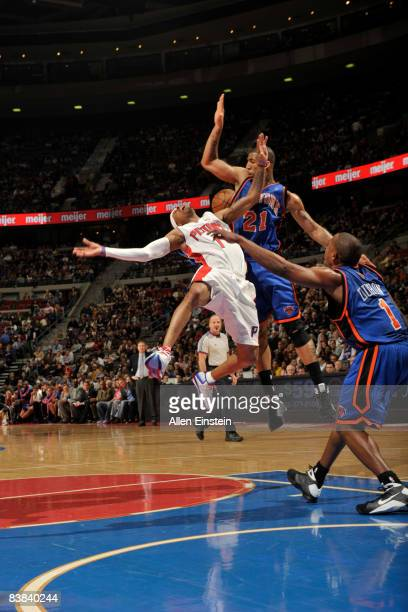 Allen Iverson of the Detroit Pistons fouled by Wilson Chandler of the New York Knicks on November 26, 2008 at the Palace of Auburn Hills in Auburn...