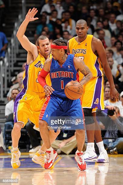 Allen Iverson of the Detroit Pistons goes up against Jordan Farmar of the Los Angeles Lakers during the game on November 14 2008 at Staples Center in...