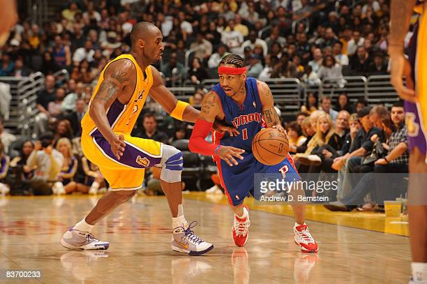 Allen Iverson of the Detroit Pistons handles the ball against Kobe Bryant of the Los Angeles Lakers at Staples Center on November 14 2008 in Los...