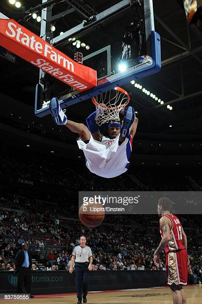 Allen Iverson of the Detroit Pistons holds on the rim after a dunk after the play during a game against the Cleveland Cavaliers on November 19 2008...