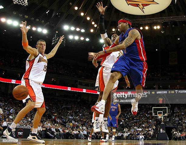 Allen Iverson of the Detroit Pistons passes against CJ Watson and Andris Biedrins of the Golden State Warriors during an NBA game on November 13 2008...