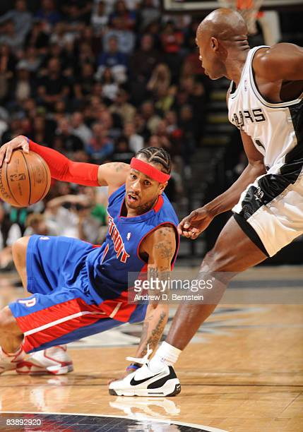 Allen Iverson of the Detroit Pistons regains his stance after falling against Jacque Vaughn of the San Antonio Spurs at the ATT Center December 2...