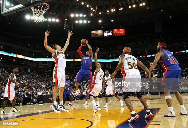 Allen Iverson of the Detroit Pistons shoots against Andris Biedrins of the Golden State Warriors during an NBA game on November 13 2008 at Oracle...