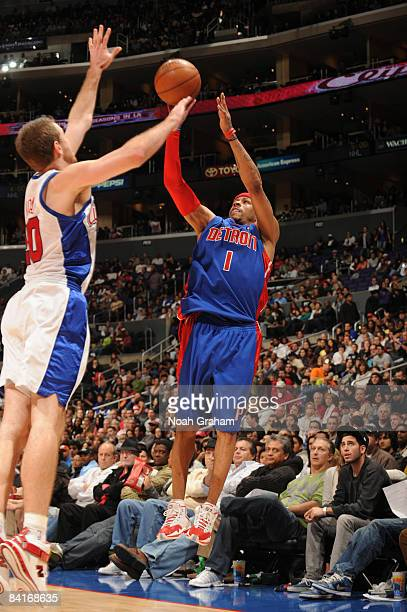 Allen Iverson of the Detroit Pistons shoots against Steve Novak of the Los Angeles Clippers at Staples Center on January 4 2009 in Los Angeles...