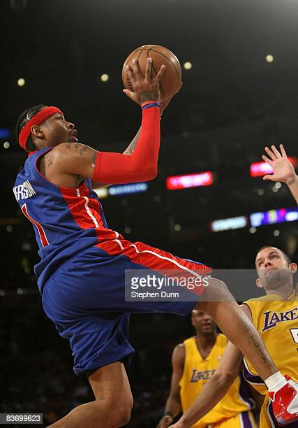 Allen Iverson of the Detroit Pistons shoots over Jordan Farmar of the Los Angeles Lakers on November 14 2008 at Staples Center in Los Angeles...